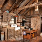 """My game plan was to try to put it together so when you walk in it looks like an old cabin that doesn't have any modern conveniences,"" John says. To that end, he hid a freezer and refrigerator on either side of the farm sink behind reclaimed barnwood cabinets. The couple also chose a rustic farm sink and modern oven with the throwback appeal of an 1800s cook stove."