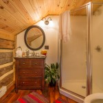 One of the only substantial additions to the previously unplumbed structure, the upstairs bathroom is simple and functional, yet subtly gorgeous — much like the cabin itself.