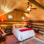 "Because the original upstairs flooring was moved downstairs, a ""new"" floor — made from red-oak planks taken off an old West Virginia barn — now graces the bedroom. Except for the addition of a ceiling fan and ventilation windows, the space looks much like it probably did in the 19th century."