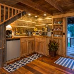 Carved out in one corner of the cabin's main level, this petite kitchenette is practical, not posh. Reclaimed-wood cabinetry gives it the feel of having been there forever, while the stainless steel under-counter fridge suggests there's no need to go overboard in the authenticity department.
