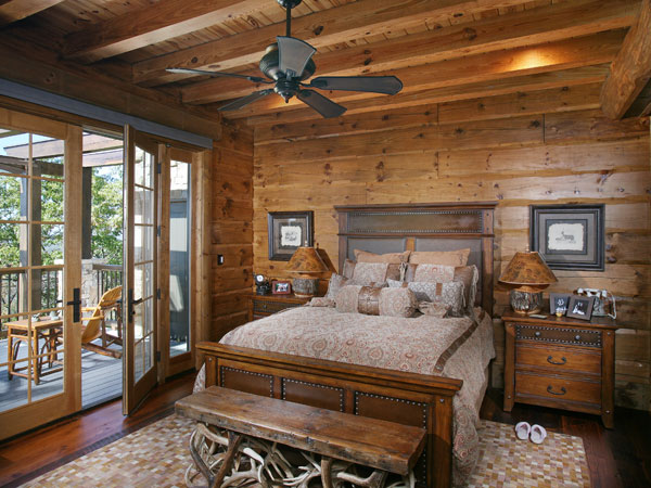 The 'self-sufficient' master suite provides plenty of privacy when the homeowners entertain overnight guests. The bedroom portion, which showcases white pine logs, leads to a private terrace, whose French doors admit abundant light.