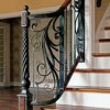 Custom-forged railings add distinctive personality to this sweeping staircase
